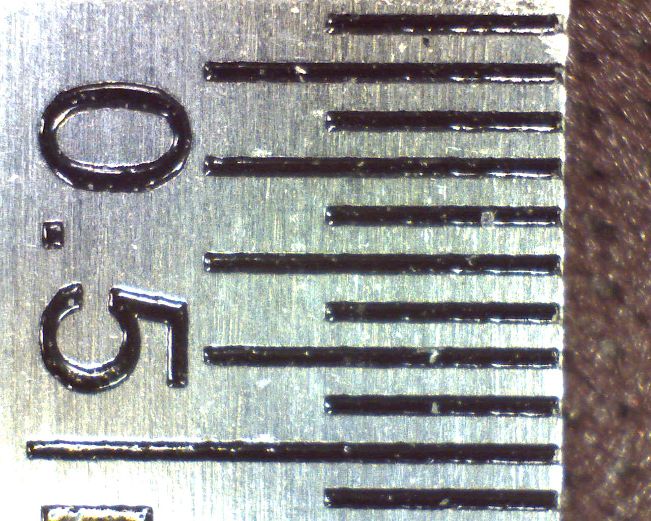Usb digital microscope's first zoom level of a ruler (markings at 0.5mm)