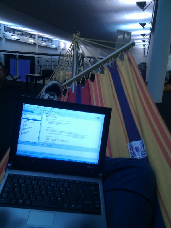 Coding in a hammock and drinking beer